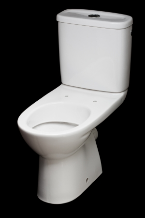 white ceramic toilet isolated on black background photo
