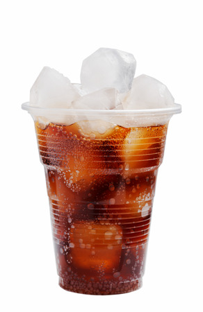 plastic glass with ice and a cola on a white background photo