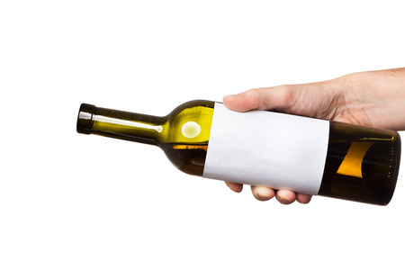 open bottle of white wine with a clear sticker in hand isolated on white background
