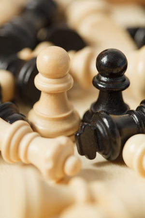 pawns: black and white chess pieces pawns surrounded closeup Stock Photo