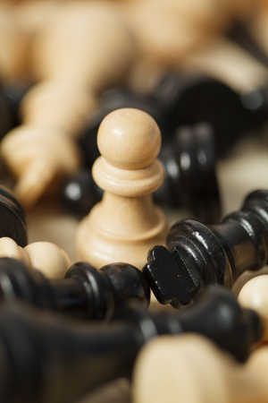 black and white chess pieces pawns surrounded closeup Stock Photo