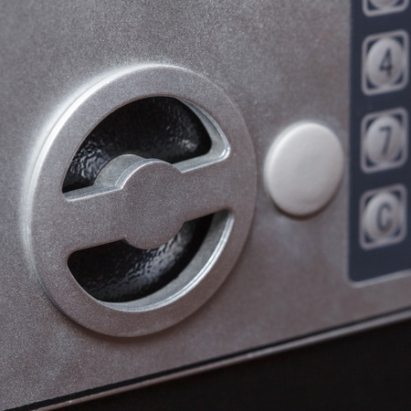 keypad: Electronic home safe keypad, Small home or hotel wall safe with keypad, closeup Stock Photo