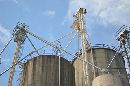 Industrial grain silos against blue sky