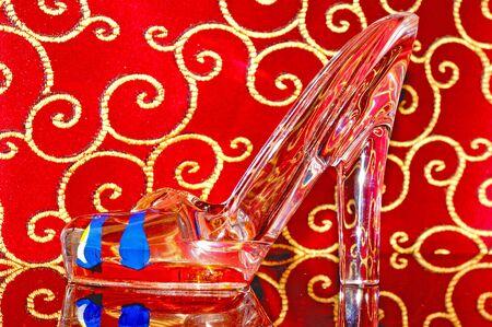 authorship: The Glass small shoe on glass table. Igrushechnaya loafer.The Product of the mass production: authorship, mark, logotype has not.