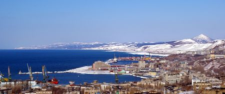 The Island Sakhalin.The Town Kholmsk.Panorama of the city on background mountain and sea landscape overhand.