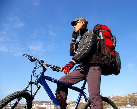 sakhalin: The Bicyclist.The Man on bicycle travels on city. Island Sakhalin, city Kholmsk.
