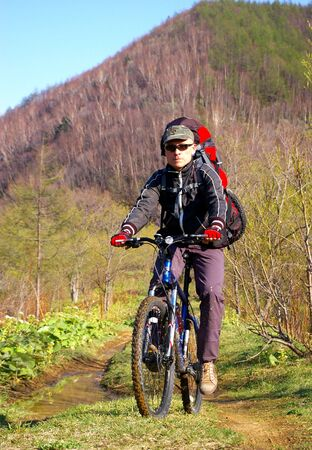 sakhalin: The Bicyclist.Man on bicycle travels on island Sakhalin