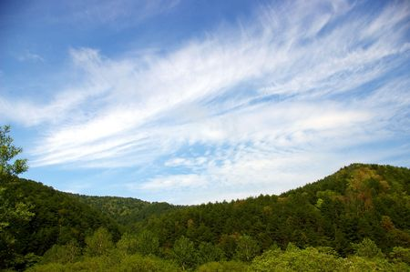 fart: Peristye cloud on mountain.On we turn blue the sky a cloud in the manner of  fart. Stock Photo
