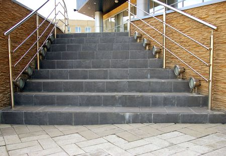 banisters: The Stairway.The Stone stairway with metallic banisters. The Element of the building stiletto modern style.