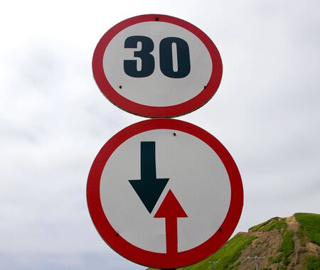 instruct: The Traffic signs advantage and speed limit. Stock Photo