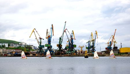 sakhalin: The Sailfishes in port.Four small boats with sail sail in seaports. Stock Photo