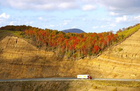 Road in autumn mountain.The Mountain  pass Kholmskiy on island Sakhalin by autumn. Stock Photo