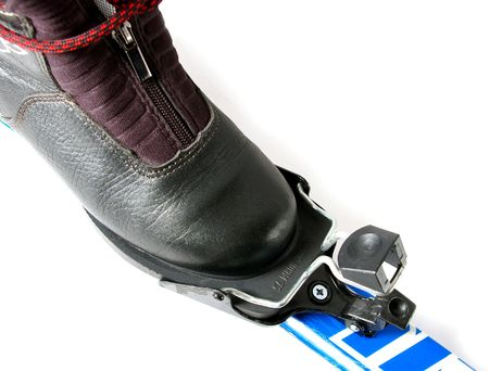 Ski boot and fastening on ski. Stock Photo