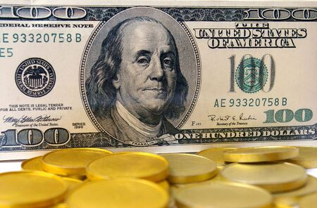 one hundred dollars: One hundred dollars and gold Stock Photo