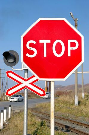 Traffic sign Stop before railway moving photo