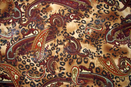 Fabrics from artificial silk  of the brown color with pattern.