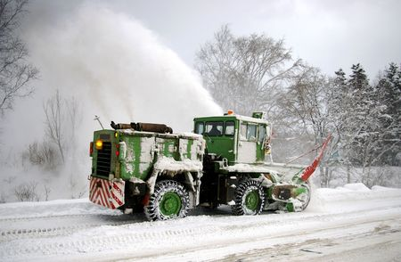 Special technician clears the snow on mountain road.  Island Sakhalin.