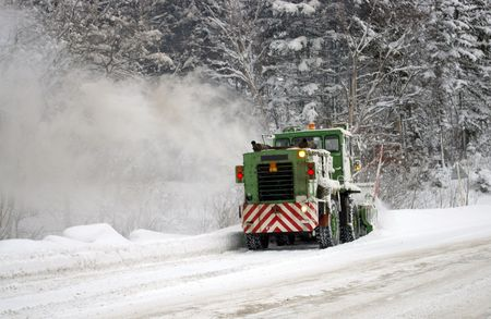 sakhalin: Special technician clears the snow on mountain road.  Island Sakhalin.
