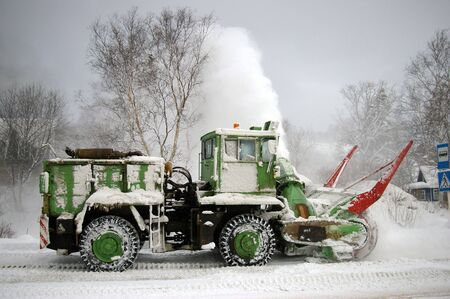 sakhalin: Special technician clears the snow on  road.  Island Sakhalin. Stock Photo