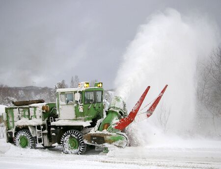 sakhalin: Special machine  clears the snow on mountain road.  Island Sakhalin.