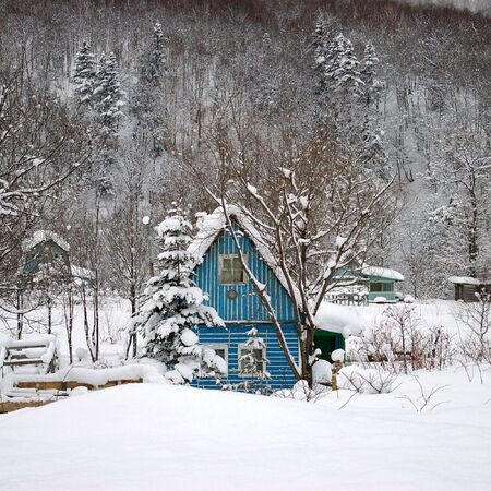 Dacha- lodge in mountain winter on Sakhalin Stock Photo