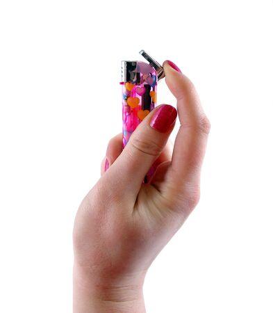 Cigarette-lighter in feminine hand on white background photo