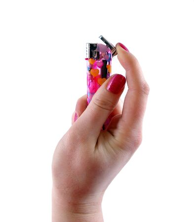 Cigarette-lighter in feminine hand on white background