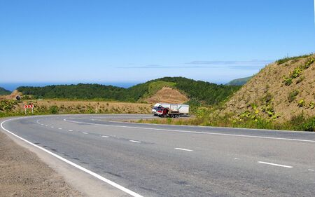 sakhalin: Tumbling of the mountain road.Mountain road on island Sakhalin by summer