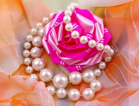 Pearl necklace and bow for gift on background fabrics. Stock Photo - 4548574