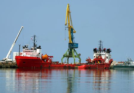 Red motorboat to oil  industry  photo