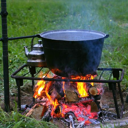 Campfire and caldron.