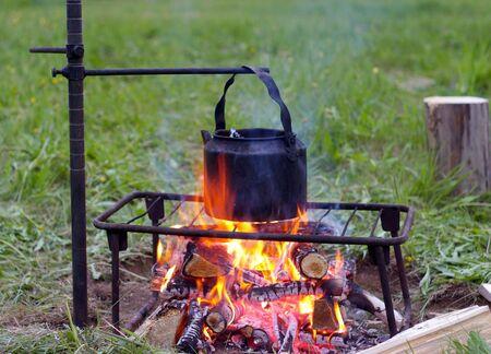 blazes: Campfire and teapot. Stock Photo