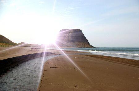 Cape Kovrizhka  on  seaside of the island Sakhalin and sun   photo