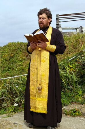 Orthodox priest reads prayer