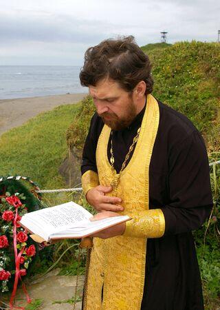 cassock: Orthodox priest reads prayer