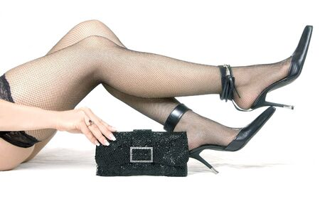 Female feet in shoes and  handbag, Side view Stock Photo - 7384534