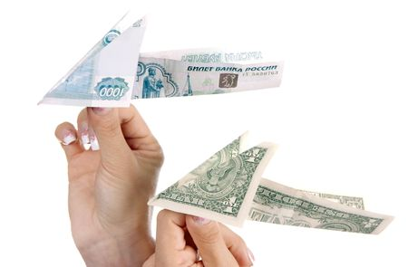 Paper planes from denominations advantage one thousand roubles and one dollar in hands photo