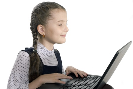 girl sits at the computer on white background photo