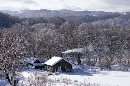 sakhalin: Winter landscape with the rural house (island Sakhalin)