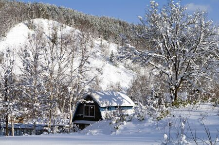 sakhalin: Snow-covered country house in December (island Sakhalin)