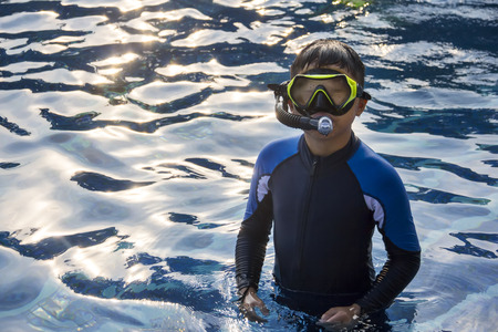 snorkelling: Happy kids snorkelling mask in water summer vacation, fun child snorkel outdoor sport, leisure activity for chilkdhood holiday Stock Photo