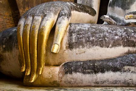Buddha Golden Hand at temple in Sukhothai, Thailand photo