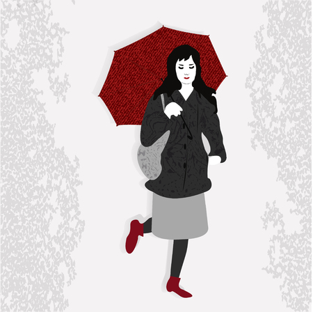Modern young girl goes slowly around the city with a beautiful umbrella.