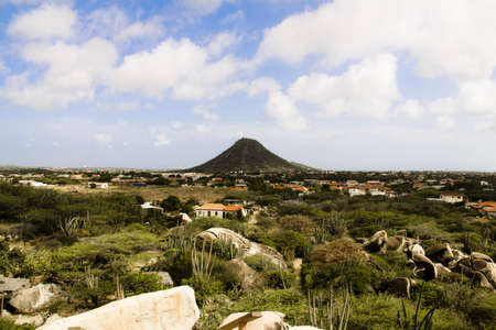 A hill top in Aruba over a shanty town in the country side.