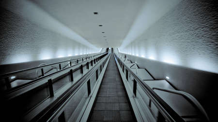 Empty escalator through tunnel photo
