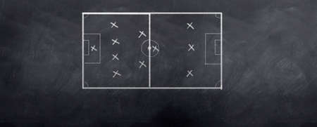 A socceer strategy board as the half time whistle blows. Written in chalk on a blackboard. Stock Photo - 6374333