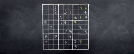 A game of sudoku played on a blackboard Archivio Fotografico