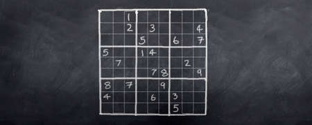 A game of sudoku played on a blackboard Stock Photo