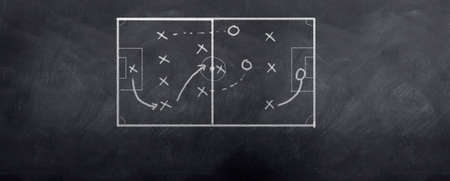 A socceer strategy board as the half time whistle blows. Written in chalk on a blackboard.