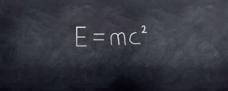 mc2: Einsteins theory is written with chalk on a blackboard Stock Photo